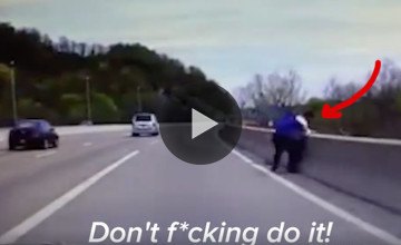 VID: Brave Officer Rescues Man Moments Before Jumping Off A Bridge