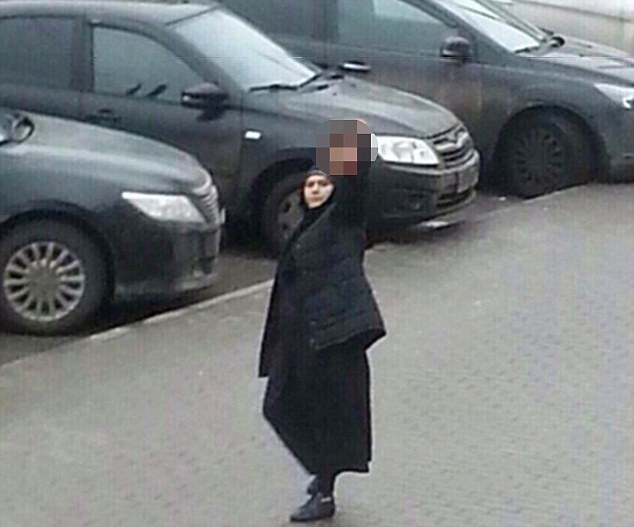"""*GRAPHIC CONTENT* This handout picture obtained on February 29, 2016 on oleg_smotra's Instagram account shows a woman, identified as 38-year-old Gyulchekhra Bobokulova, holding the severed head of a child near a metro station in northwest Moscow. Russian police on February 29 arrested a nanny for beheading a young girl in her care, investigators said, with local media reporting she was arrested while carrying the child's severed head. AFP PHOTO / INSTAGRAM / OLEG_SMOTRA ==RESTRICTED TO EDITORIAL USE - MANDATORY CREDIT """"AFP PHOTO / INSTAGRAM / OLEG_SMOTRA"""" - NO MARKETING - NO SALES - NO ADVERTISING CAMPAIGNS - DISTRIBUTED AS A SERVICE TO CLIENTS ==OLEG_SMOTRA/AFP/Getty Images"""