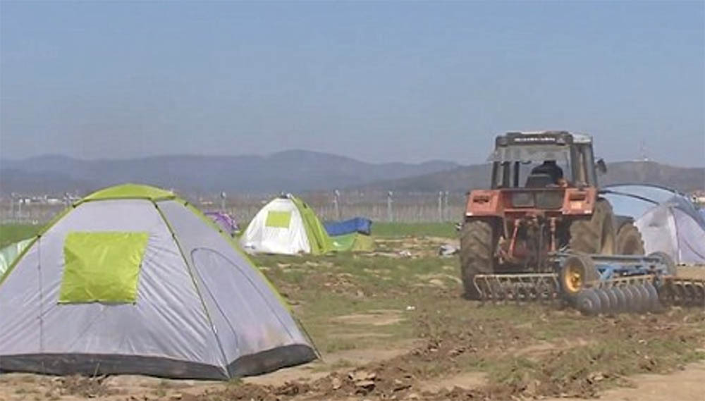 VIDEO: Farmer smashes through migrants' tents with his TRACTOR after they set up camp on his fields